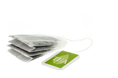 Tea paper sachet with green label Royalty Free Stock Photo