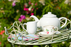 Tea Party. Garden tea party with pretty cup and saucer on butlers tray royalty free stock photos