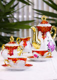 Tea Party. Closeup of a beautiful porcelain tea set. (focus is on center objects Royalty Free Stock Photos