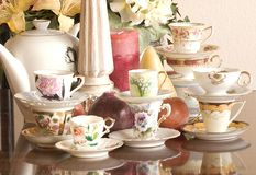Tea Party. Vintage tea cups, tea pot, candles and flowers, just add finger sandwiches or chocolate truffles for an afternoon tea party or just use as a Royalty Free Stock Photo