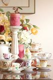 Tea Party. Vintage tea cups, tea pot, candles and flowers, just add finger sandwiches or chocolate truffles for an afternoon tea party or just use as a Royalty Free Stock Images