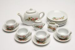 Tea party. Miniature tea party set in porcelain white used in play stock photos