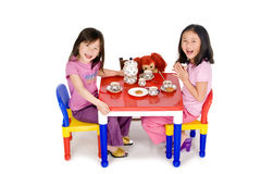 Tea Party. Two young asian girls having a tea party Stock Photography