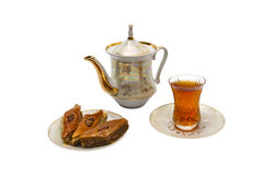 Tea party with baklava. Still life with teakettle, saucer and baklava. Isolated royalty free stock photos