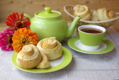 Tea party and buns Stock Photography