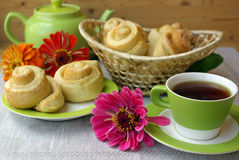 Tea party and buns Stock Images