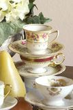 Tea Party closeup. Vintage tea cups, tea pot, candles and flowers, just add finger sandwiches or chocolate truffles for an afternoon tea party or just use as a Stock Image