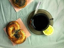 Tea Party. Cup of tea with fresh sweet rolls Stock Photo