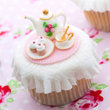 Tea party cupcake Stock Images