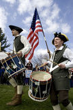 Tea party drummers. Men dressed in colonial style attire beat the drums upon entering the tea party event Stock Photography