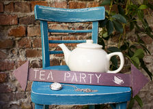 Tea party At The Garden. With Watch Hanging Royalty Free Stock Photos
