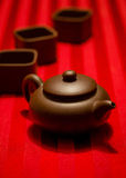 Tea Party Parade. Chinese tea set on a red striped table cloth Royalty Free Stock Photos