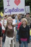 "Tea Party Patriots Love Capitalism, Denver. DENVER, COLORADO – APRIL 15: Two women hold a sign stating ""I Love Capitalism"" at the Tea Party Patriots Tax Stock Images"