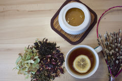 Tea party preparation. Tea leaves, tea сup, honey, bouquet of dried flowers Royalty Free Stock Photos