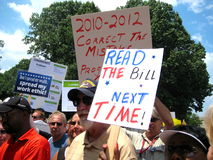Tea Party Sign: Read the Bill. WASHINGTON, DC - JULY 4, 2009: A Tea Partier holds up a sign saying Read the Bill Next Time Stock Photo