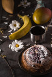 Tea party still ife with fruits and flowers on the stone background Stock Photography