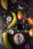 Tea party still ife with fruits and flowers vertical Stock Photo