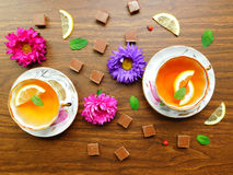 Tea-party for two. Composition made of teacups,chocolate and fresh flowers Royalty Free Stock Photo
