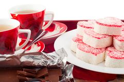 Tea party for two with heart-shaped Cake Stock Photos