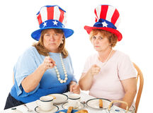 Tea Party Voters - Upset. Two conservative American Tea Party voters, angrily pointing their fingers Royalty Free Stock Photography