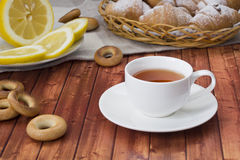 Tea with pastries. Black tea on the table with fresh pastries Stock Photos