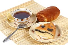 Tea and pastry. This picture depicts tea with lemon and pastry Royalty Free Stock Images