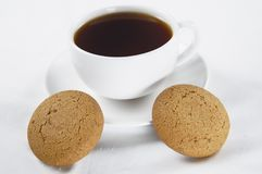 Tea and pastry. Oatmeal cookies and a cup of tea Royalty Free Stock Photography