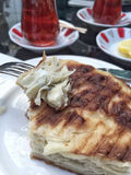 Tea and patty for a traditional turkish breakfast. On table Stock Photography