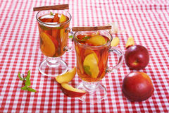 Tea with peach Stock Images