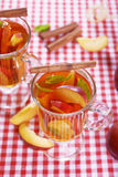 Tea with peach Royalty Free Stock Images