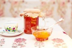 Tea with peach jam retro. Imitation retro background with the image Tea with peach jam royalty free stock photo