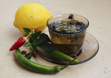 Tea, peppers,lemon natural remedies vs pills Royalty Free Stock Photography