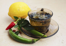 Tea, peppers,lemon natural remedies vs pills Stock Photo
