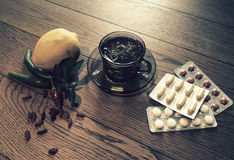 Tea, peppers,lemon natural remedies vs pills Royalty Free Stock Images