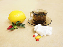Tea, peppers,lemon natural remedies vs pills Stock Photography