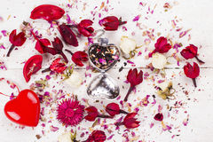 Tea with petals of roses. Tea in strainers in the form of heart with petals of roses Stock Images