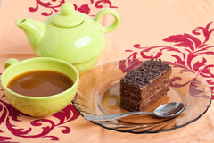 Tea and piece of chocolate cake. On the table Royalty Free Stock Photography