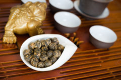Tea in a white cup. Chinese tea pile in a cup closeup Stock Image