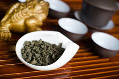 Tea in a cup. Chinese tea pile in a cup closeup Stock Images