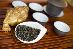Tea leaves in macro. Chinese tea pile in a cup closeup Stock Photo