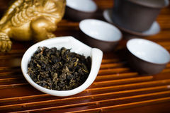 Tea leaves in cup macro. Chinese tea pile in a cup closeup Stock Images