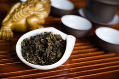 Chinese tea leaves. Chinese tea pile in a cup closeup Royalty Free Stock Image