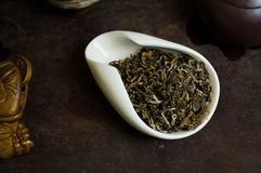 Tea in a cup. Chinese tea pile in a cup closeup Royalty Free Stock Photography