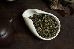 Tea pile on table in white cup. Chinese tea pile in a cup closeup Royalty Free Stock Photo