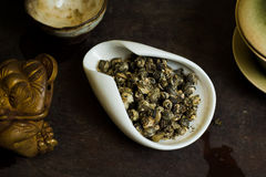 Tea pile in cup on table. Chinese tea pile in a cup closeup Stock Image