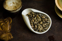 Tea pile served on table. Chinese tea pile in a cup closeup Stock Image
