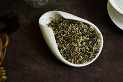 Tea pile in cup macro. Chinese tea pile in a cup closeup Stock Photos