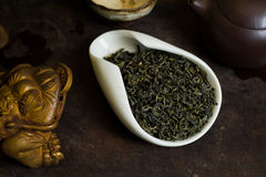 Tea leaves pile on table. Chinese tea pile in a cup closeup Royalty Free Stock Images