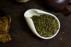 Pile of chinese tea on table in cup. Chinese tea pile in a cup closeup Stock Photo