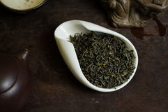 Tea in a cup macro. Chinese tea pile in a cup closeup Royalty Free Stock Images